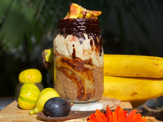 Carob - Tahini overnight oats with roasted bananas, figs and carob chocolate glaze