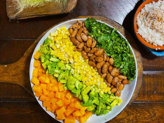 Positive pranic Mango/ Avocado salad with beans, corn, and precisely. Sattvic kitchen, plant-based diet